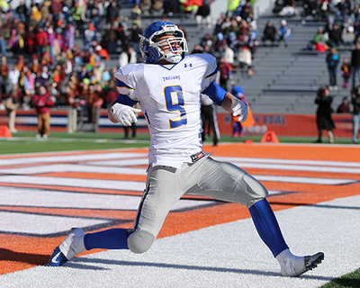 Maroa-Forsyth High School quarterback, Jack Hockaday, celebrates after making is 3rd rushing touchdown in the 2012 IHSA Class 1A State Football Championship.